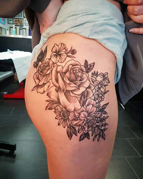 Flowers and a Butterfly Thigh Tattoo