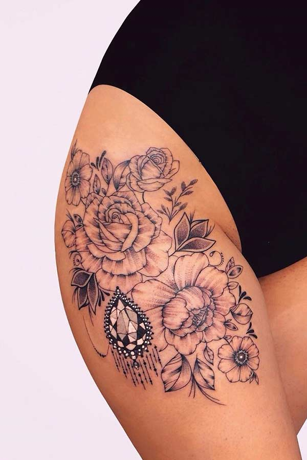 Roses and Flowers Thigh Tattoo