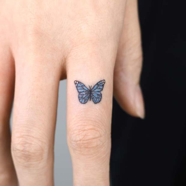 Tiny Butterfly Finger Tattoo
