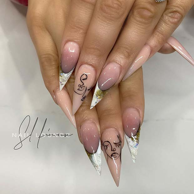 Artistic Stiletto Nails with White Tips
