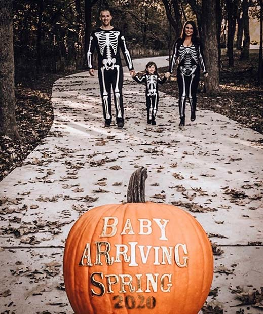 Skeleton Family with a Pumpkin Announcement