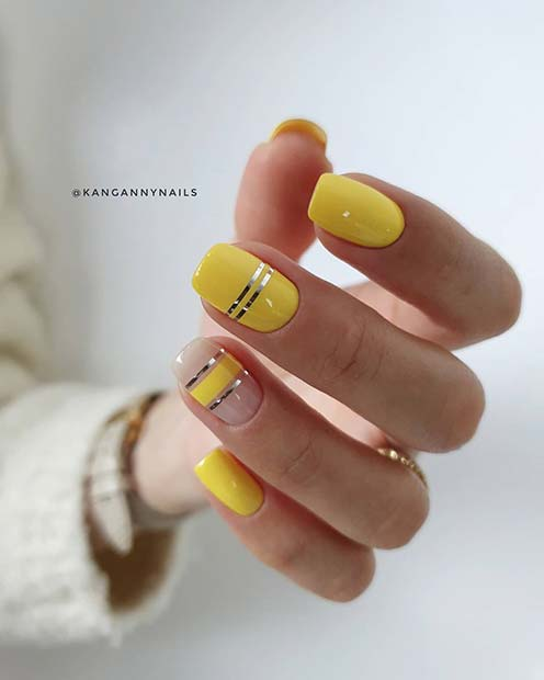Trendy Yellow Nails with Silver Stripes